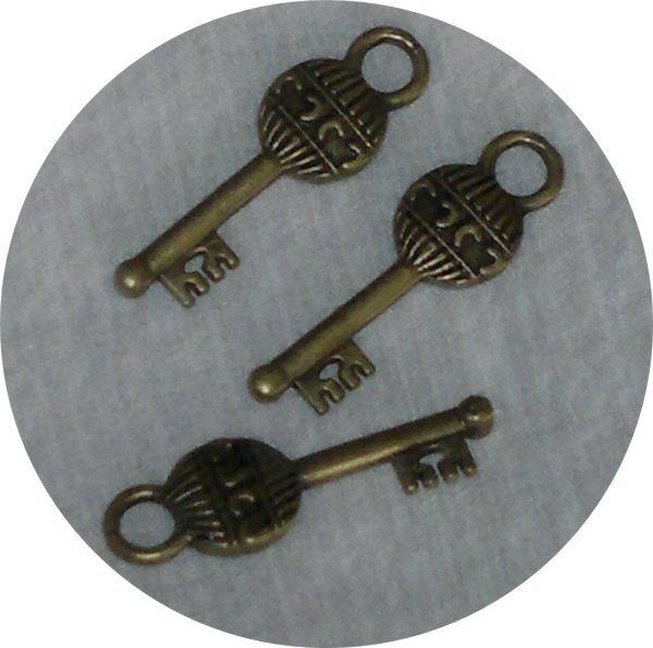 Ключе сребристо,медено,зелено 18х22мм